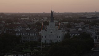 AX61_057 - 5K stock footage aerial video ascend and approach St. Louis Cathedral at sunset, French Quarter, New Orleans, Louisiana