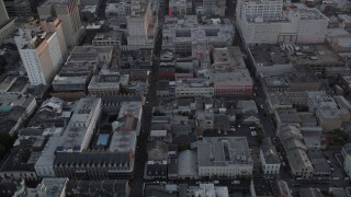 AX61_059 - 5K stock footage aerial video of French Quarter's famous Bourbon Street and cross streets at sunset, New Orleans, Louisiana