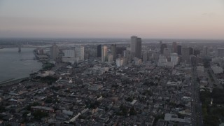 AX61_061 - 5K stock footage aerial video of the French Quarter and skyscrapers in Downtown New Orleans at sunset, Louisiana