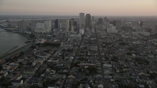 AX61_062 - 5K stock footage aerial video of a view across the French Quarter at Downtown New Orleans at sunset, Louisiana