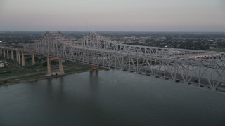AX61_065 - 5K stock footage aerial video of light traffic on the Crescent City Connection Bridge at sunset, New Orleans, Louisiana