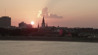 AX61_068 - 5K stock footage aerial video of St. Louis Cathedral in the French Quarter of New Orleans, seen from the river at sunset, Louisiana
