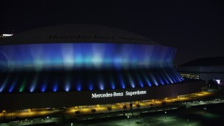 AX62_001 - 5K stock footage aerial video of ascending from the Mercedes-Benz Superdome at night, New Orleans, Louisiana