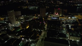AX62_008 - 5K stock footage aerial video follow Poydras Street to hotels in Downtown New Orleans at night, Louisiana