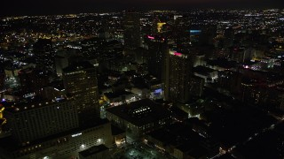 AX62_010 - 5K stock footage aerial video fly over Marriott and Sheraton hotels to approach Place St Charles at night, Downtown New Orleans, Louisiana