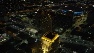 AX62_011 - 5K stock footage aerial video fly over skyscrapers and approach the Superdome in Downtown New Orleans at night, Louisiana