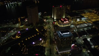 AX62_014 - 5K stock footage aerial video follow Poydras Street past hotels in Downtown New Orleans at night, Louisiana