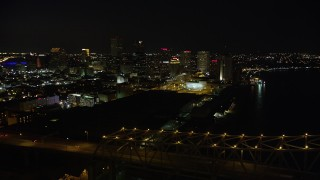 AX62_017 - 5K stock footage aerial video of Crescent City Connection Bridge and Downtown New Orleans, Louisiana at night