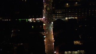 AX62_022 - 5K stock footage aerial video of bird's eye view of a crowd on Bourbon Street in the French Quarter at night, New Orleans, Louisiana