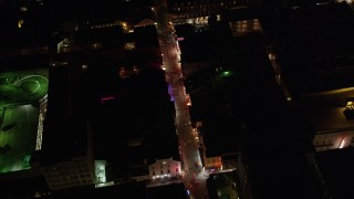 AX62_026 - 5K stock footage aerial video bird's eye of historic Bourbon Street through French Quarter at night, New Orleans, Louisiana