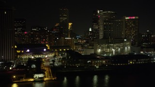 AX62_035 - 5K stock footage aerial video fly low by Harrah's and hotels in Downtown New Orleans at night, Louisiana