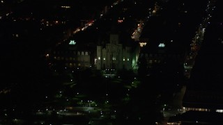 AX62_039 - 5K stock footage aerial video flyby Jax Brewery to reveal St. Louis Cathedral and Jackson Square at night, French Quarter, New Orleans, Louisiana