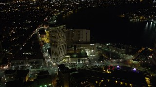 AX62_044 - 5K stock footage aerial video fly over Harrah's and The Westin Canal Place to approach French Quarter at night, Louisiana