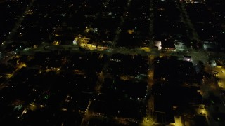 AX62_046 - 5K stock footage aerial video urban homes around St. Claude Avenue and Elysian Fields Avenue at night, Gentilly New Orleans, Louisiana