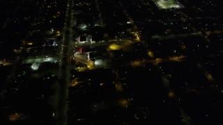 AX62_047 - 5K stock footage aerial video of urban neighborhoods around St Roch Park at night, New Orleans, Louisiana