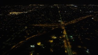 AX62_048 - 5K stock footage aerial video approach freeway interchange in at night, New Orleans, Louisiana