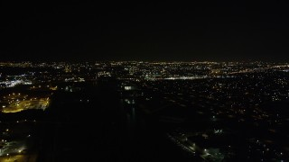 AX63_002 - 5K stock footage aerial video fly over Industrial Canal to approach Gentilly at night, New Orleans, Louisiana
