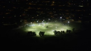 AX63_003 - 5K stock footage aerial video of a baseball field in Gentilly at night, New Orleans, Louisiana