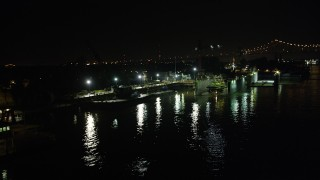 AX63_010 - 5K stock footage aerial video flyby Algiers Ferry Terminal and piers on the Mississippi River at night in Algiers, New Orleans, Louisiana