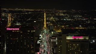 AX63_018 - 5K stock footage aerial video pan across Downtown New Orleans at night, revealing Canal Street, Louisiana