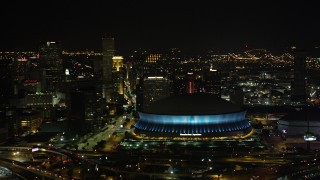 AX63_021 - 5K stock footage aerial video of the Superdome and Downtown New Orleans skyscrapers at night, Louisiana