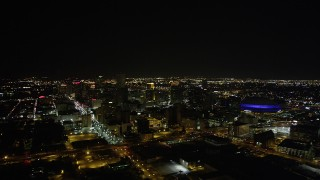 AX63_028 - 5K stock footage aerial video of a wide view of Downtown New Orleans at night, Louisiana