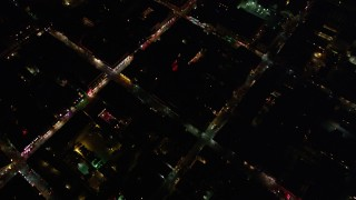 AX63_029 - 5K stock footage aerial video of a bird's eye view of the French Quarter, including Bourbon Street, at night, New Orleans, Louisiana