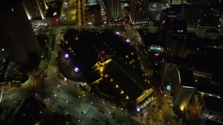 AX63_030 - 5K stock footage aerial video of bird's eye view of The Westin and Harrah's at night in Downtown New Orleans, Louisiana