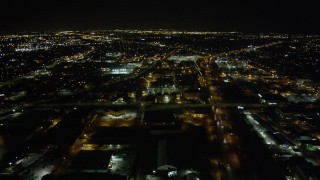 AX63_033 - 5K stock footage aerial video approach Xavier University of Louisiana beside Interstate 10 in Mid-City New Orleans at night, Louisiana