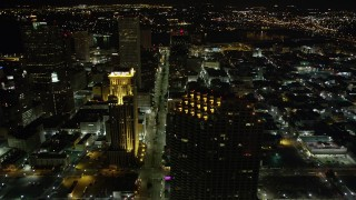 AX63_041 - 5K stock footage aerial video of following Poydras Street through Downtown New Orleans at night, Louisiana
