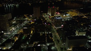 AX63_042 - 5K stock footage aerial video fly over Poydras and Canal Streets in Downtown New Orleans at night, Louisiana