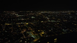 AX63_043 - 5K stock footage aerial video of neighborhoods in the Upper Ninth Ward at night, New Orleans, Louisiana