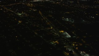 AX63_045 - 5K stock footage aerial video fly over streets and neighborhoods in Upper Ninth Ward at night, New Orleans, Louisiana