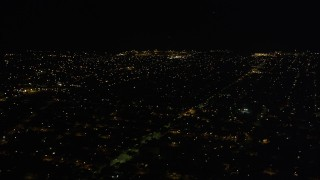 AX63_047 - 5K stock footage aerial video of residential neighborhoods in Gentilly at night, New Orleans, Louisiana