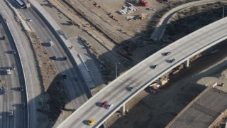 AX64_0003 - 5K stock footage aerial video of Interstate 5 / Highway 170 freeway split with light traffic, Pacoima, California