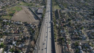 AX64_0004 - 5K stock footage aerial video of Highway 170 freeway traffic through residential neighborhoods, North Hollywood, California