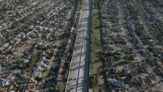 AX64_0005 - 5K stock footage aerial video of Highway 170 freeway traffic through suburban neighborhoods in North Hollywood, California