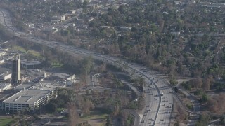 AX64_0006 - 5K stock footage aerial video of Highway 170 with light traffic beside a shopping center in North Hollywood, California