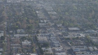 AX64_0009 - 5K stock footage aerial video of office and apartment buildings along Laurel Canyon Boulevard in North Hollywood, California