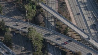 AX64_0011 - 5K stock footage aerial video of light traffic on the Highway 170 interchange with Highway 134 in North Hollywood, California