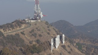 AX64_0017 - 5K stock footage aerial video of emergency helicopter landing above the Hollywood Sign, Los Angeles, California