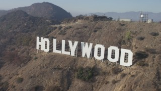 AX64_0021 - 5K stock footage aerial video approach and fly over the Hollywood Sign, Los Angeles, California