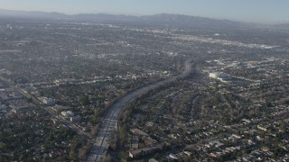 AX64_0027 - 5K stock footage aerial video of the Highway 170 freeway between suburban neighborhoods in North Hollywood, California