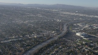 AX64_0029 - 5K stock footage aerial video of light traffic on Highway 170 and suburban neighborhoods, North Hollywood, California