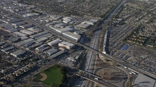 AX64_0030 - 5K stock footage aerial video of warehouse buildings beside Highway 170 freeway in North Hollywood, California