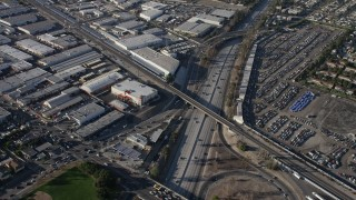 AX64_0031 - 5K stock footage aerial video tilt to light traffic on Highway 170 by warehouse buildings in North Hollywood, California