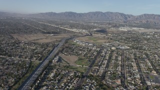 AX64_0032 - 5K stock footage aerial video fly over suburban homes to approach Highway 170 / I-5 freeway split in Sun Valley, California