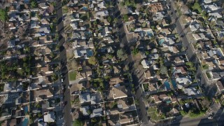 AX64_0033 - 5K stock footage aerial video of a bird's eye view of suburban neighborhoods in Sun Valley, California