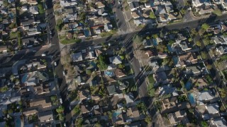 AX64_0034 - 5K stock footage aerial video of a bird's eye view of suburban homes in Sun Valley, California