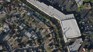 AX64_0035 - 5K stock footage aerial video of suburban homes and Canyon Plaza Shopping Center in Sun Valley, California